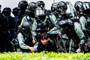 A man has pepper spray washed from his face by police having been detained after a demonstration against parallel trading in Sheung Shui.