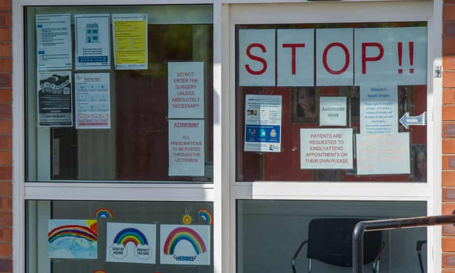 Signs on a GP surgery window in July 2020.