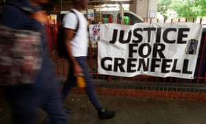 A sign reading Justice for Grenfell near the site of the blaze in west London.