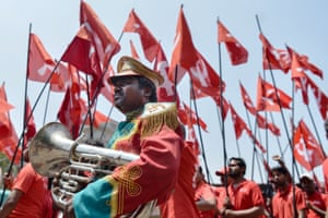 Bangalore, India Workers and members of various trade unions dressed in red take part in a rally