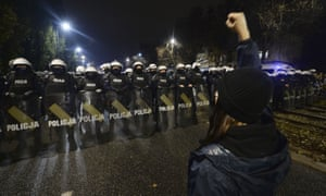 Riot police line up