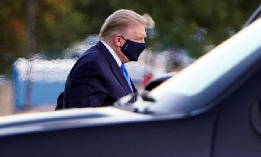 President Trump arrives at a hospital in Bethesda, Maryland.