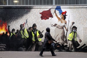 """Paris, France A mural, inspired by a painting by Eugene Delacroix, """"La Liberte guidant le Peuple"""" (Liberty Leading the People), by street artist PBOY depicts Yellow Vest (gilets jaunes) protesters"""