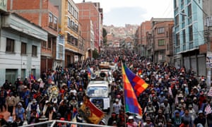 Supporters of the former Bolivian president Evo Morales carry a coffin of people they say were killed during recent clashes with security forces in La Paz on Thursday.