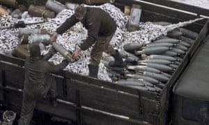 Ukrainian soldiers unload ammunition in Avdiivka