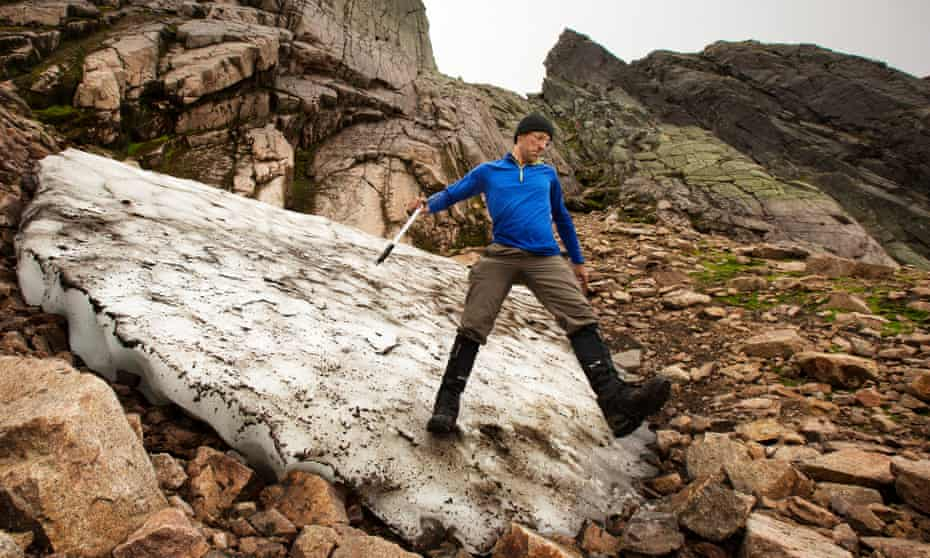 Iain Cameron takes measurements of Sphinx snow patch as it melts away, in Scotland's Cairngorms