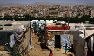 Syrian children play in a makeshift refugee camp in Lebanon's Bekaa Valley.