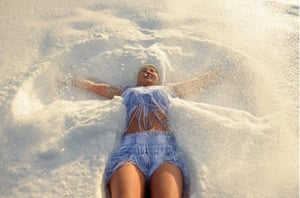 Tomsk, RussiaA woman makes a snow angel as she takes part in a running event