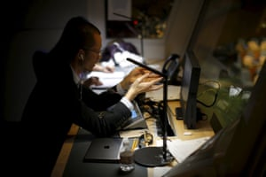 A Chinese interpreter translates in a booth above the general assembly hall during a meeting