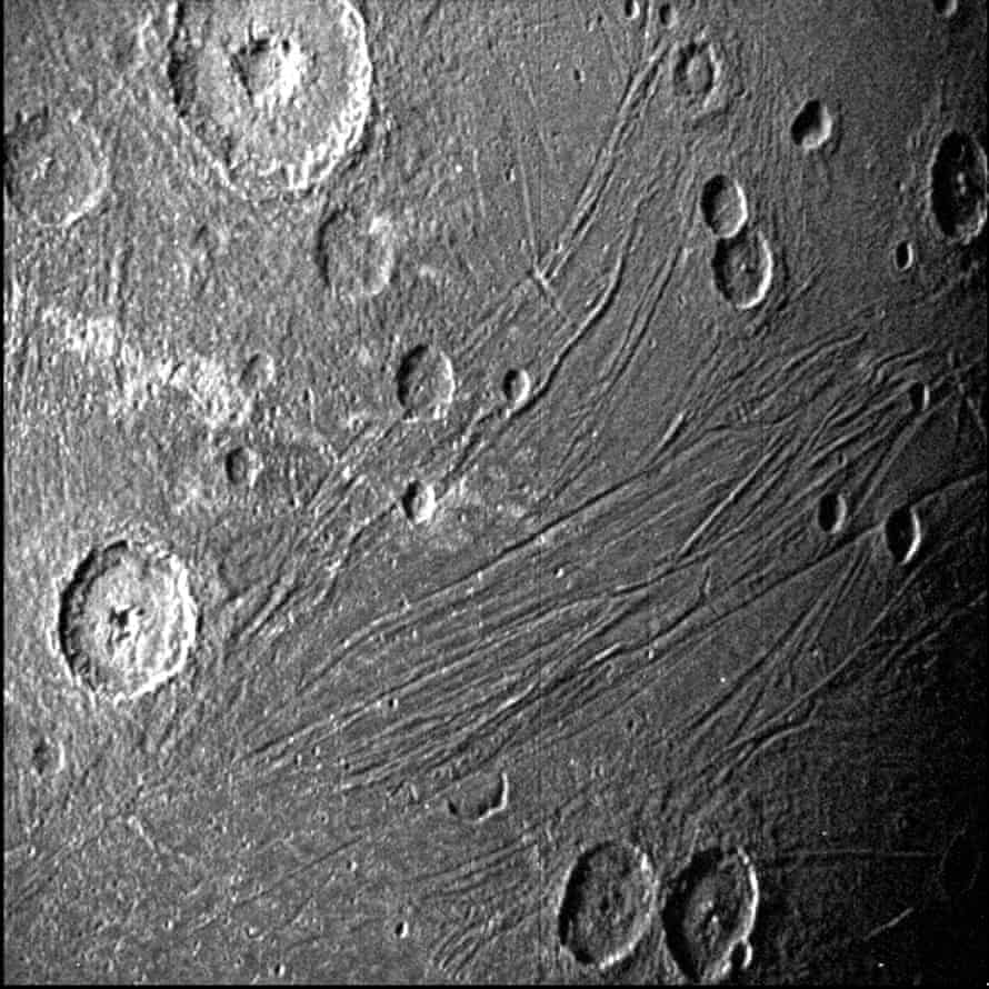 A Nasa image shows the dark side of Ganymede as the Juno spacecraft flies by.