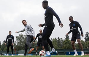 Gareth Southgate with Kyle Walker, Trent Alexander-Arnold, Danny Welbeck and Raheem Sterling at a training ground near St Petersburg.