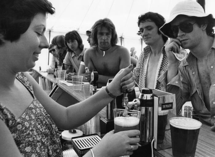Clare Haver pulls one of the thousands of pints consumed at the tournament, helping cool punters on 5 July 1976.