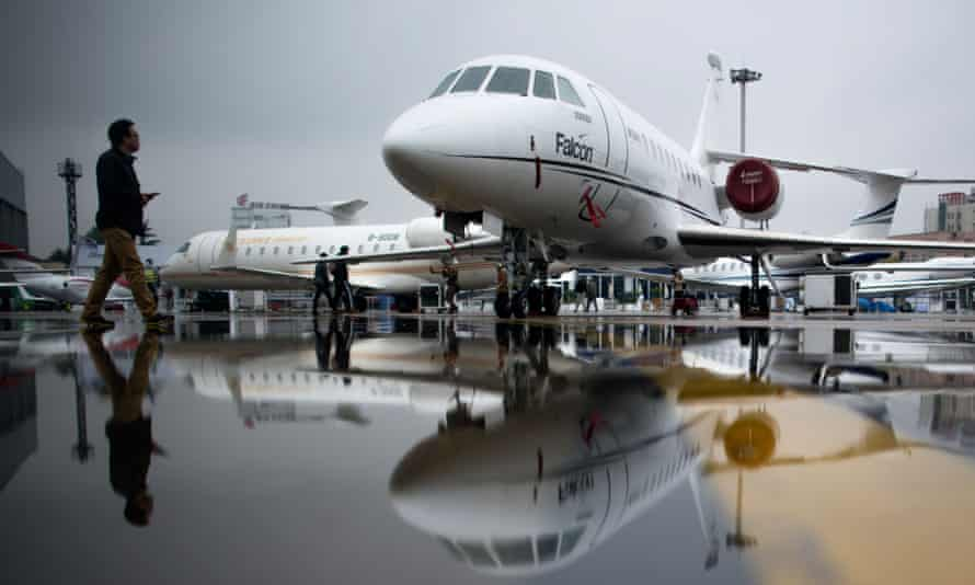A man walking past a business jet before the start of the 2017 Asian Business Aviation Conference and Exhibition (ABACE) at Shanghai's Hongqiao Airport.