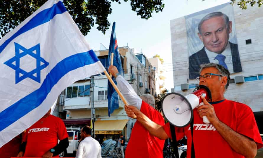 Supporters of the Israeli Labor party at a rally against  Benjamin Netanyahu outside the Likud party HQ in Tel Aviv.