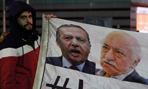 A demonstrator holds a flag bearing images of Turkey's president, Recep Tayyip Erdoğan, and US-based cleric Fethullah Gülen, during a protest in Istanbul.