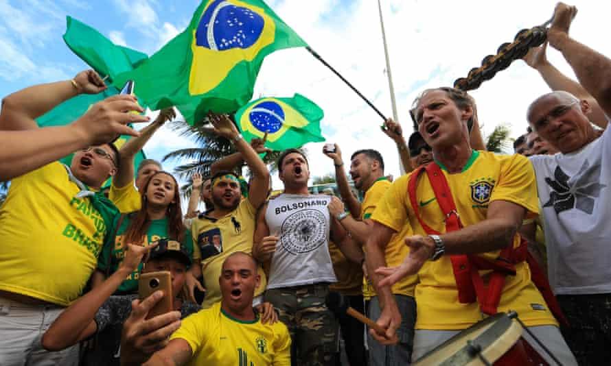 Supporters of Jair Bolsonaro take part in a rally in Rio de Janeiro