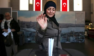 A woman votes in a mosque in Amsterdam.