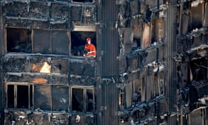 Firefighters inside the charred remains of Grenfell Tower on Saturday 17 June.