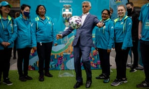 Sadiq Khan, the mayor of London plays with a football as the Uefa Euro 2020 trophy arrives in London.