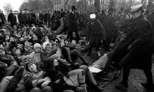 Police drag away anti-nuclear demonstrators at the Greenham Common in 1982.