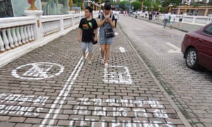Mind your step: The mobile phone lane for pedestrians in Chongqing, China.
