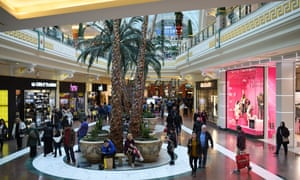 Shoppers in the Trafford Centre, a shopping mall until recently owned by Peel Holdings.