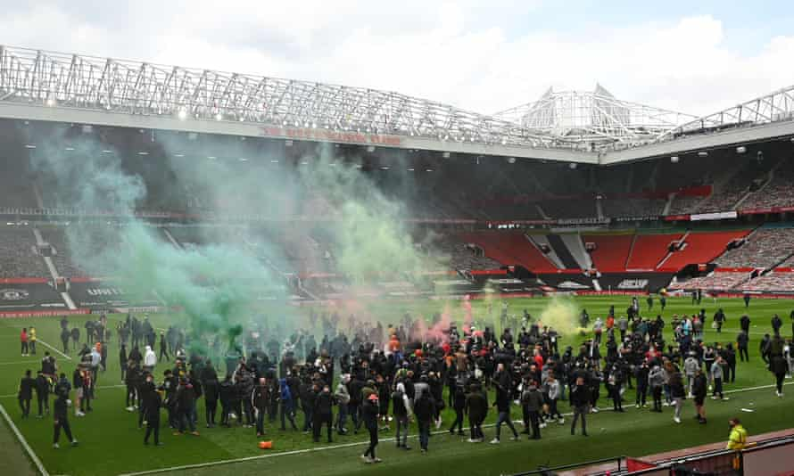 Manchester United fans protest on the Old Trafford pitch