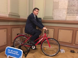 The mayor, Kari Karjalainen, uses a static bike to power the PA system at the Winter Cycling Congress.