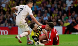 Watford's Craig Cathcart collides with keeper Ben Foster as they thwart Manchester United's Alexis Sanchez.