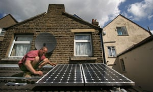 Solar panels being installed at a house in south-east London