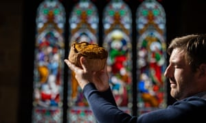 James Fryer checks over a cold meat filled pie at the British Pie Awards held at St. Mary's Church, Melton Mobray