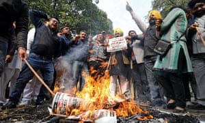 People burn placards and effigies of India's main opposition Congress party leaders, Sajjan Kumar and Kamal Nath, during a protest near the party's headquarters in New Delhi.