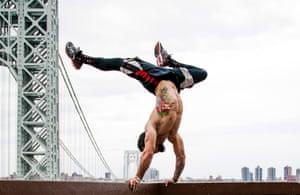 Athlete Samer Delgado in a handstand on the George Washington Bridge, New York