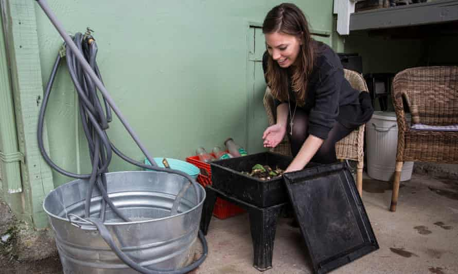 Kathryn Kellogg checks on her compost bin, where she uses worms to break down biodegradable waste.