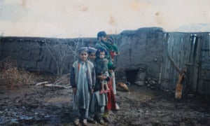 Gulwali Passarlay with his uncle, cousins and brother Noor (left) in 2002