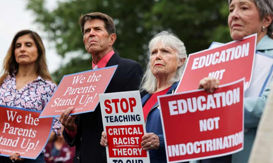 Opponents of the academic doctrine known as critical race theory protest outside the Loudoun County School Board headquarters, in Ashburn, Virginia, on June 22, 2021.