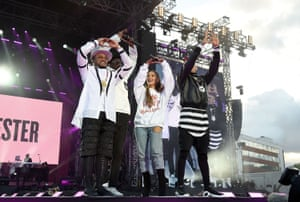 Ariana Grande performs on stage with apl.de.ap (L) will.i.am (2nd L) and Taboo of The Black Eyed Peas during the One Love Manchester Benefit Concert