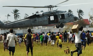 Miskito Indians surround a US helicopter bringing humanitarian aid to north-eastern Nicaragua, in September 2007.