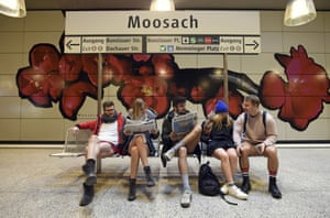 Participants in the No Pants Subway Ride sitting at Moosach underground station in Munich, Germany