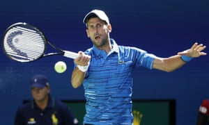 Serbia's Novak Djokovic returns a shot to Roberto Carballes Baena of Spain.