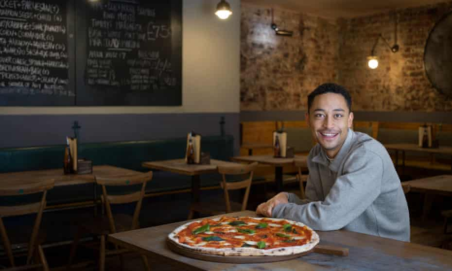 Loyle Carner at Homeslice pizza restaurant in Fitzrovia, London.