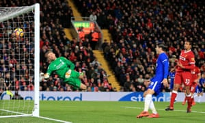 Liverpool goalkeeper Simon Mignolet dives in vain as Chelsea's Willian scores the equaliser