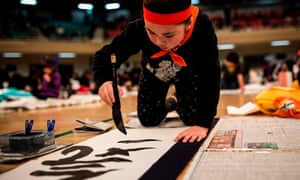 A participant writes Japanese calligraphy during the annual new year calligraphy contest in Tokyo on January 5, 2019.