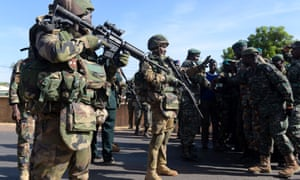 Soldiers from the Gambia greet Ecowas troops in Farafenni.