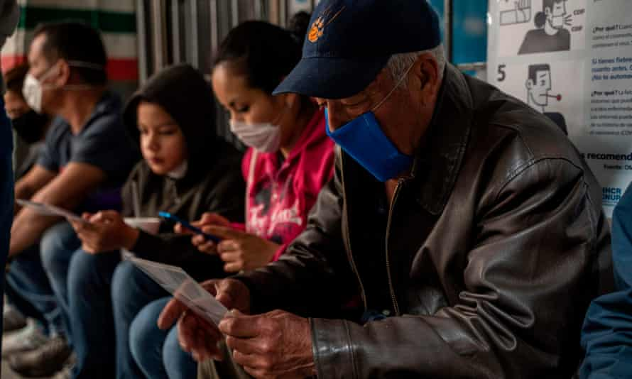 Mauricio, 66, from Honduras looks at a brochure on Covid-19 in Ciudad Juarez. A US policy that seeks to expel migrants because of the pandemic violates the law, the UN says.