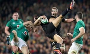 Ireland's Rob Kearney clatters into Rieko Ioane.