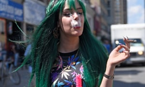 A teenage girl smoking up Marijuana during the Toronto Global Marijuana march.