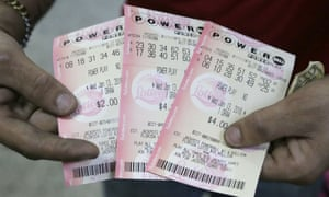 A customer shows his Powerball tickets at a grocery store in Florida.