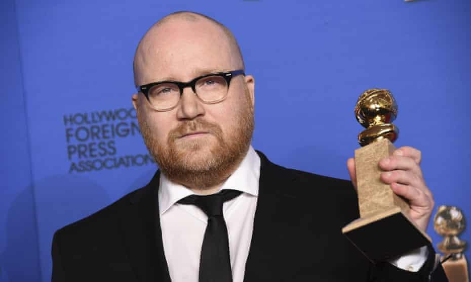 Johann Johannsson holds his Golden Globe award