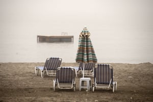 Empty beach chairs in the village of Zygi on the south coast of Cyprus